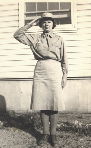 WAAC member salutes while wearing the Khaki Service Uniform.